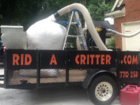 Huge filter bag full of contaminated insulation on a rid a critter trailer