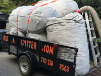 A trailer full of huge bags of contaminated insulation removed from an attic