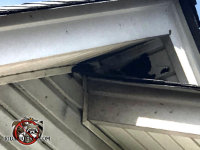 Raccoon tore away several sections of soffit panel to get into the attic of a house in Winder Georgia